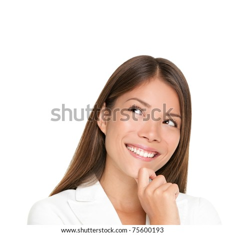 thinking woman isolated on white background looking up smiling having an idea. Beautiful young mixed race woman in business suit - stock photo