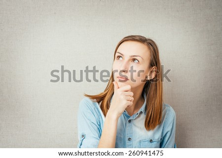 Thinking woman looking up - stock photo