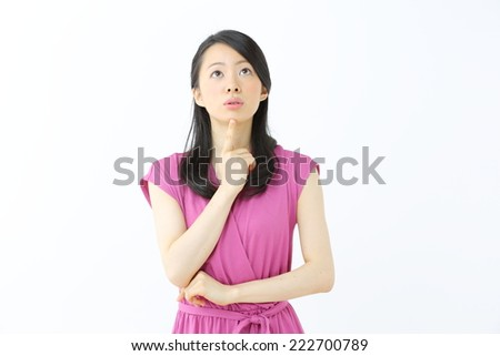 thinking woman looking up, isolated on white background - stock photo