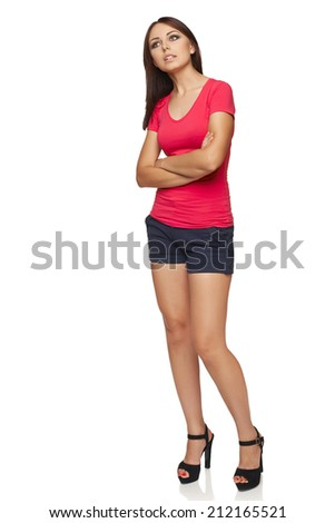 Thinking woman standing in full body isolated on white background contemplating looking up to the side  - stock photo
