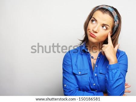 Thinking woman. Studio shot. - stock photo