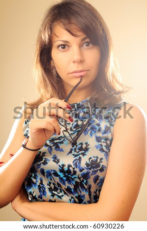 Thinking woman with glasses - stock photo