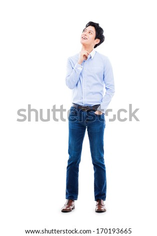 Thinking young Asian man isolated on white background.  - stock photo