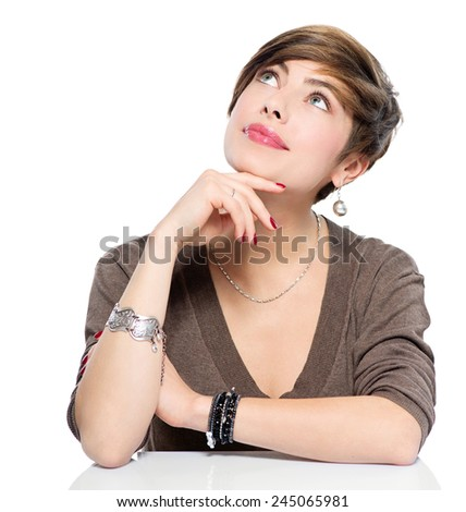 Thinking Young beauty woman looking up, isolated on white background. Copy space. Portrait of attractive girl with brown short hair wearing accessories. New idea. Advertisement. - stock photo