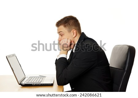 Thinking young businessman at the computer