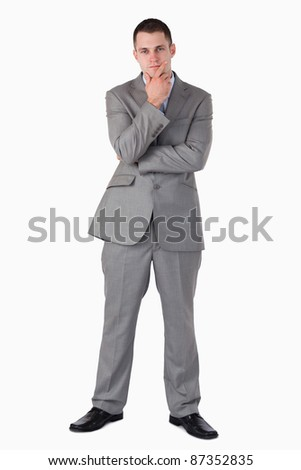 Thinking young businessman on white background