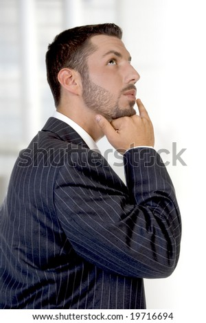 thinking young executive on an abstract background - stock photo