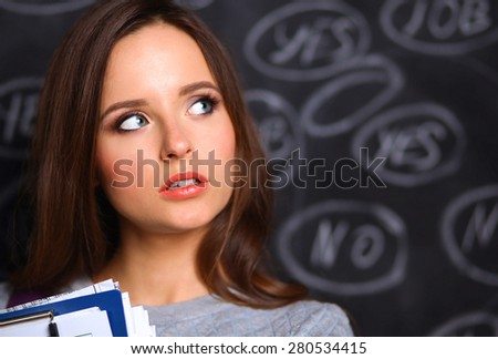 Thinking young woman with yes or no choice on gray background - stock photo
