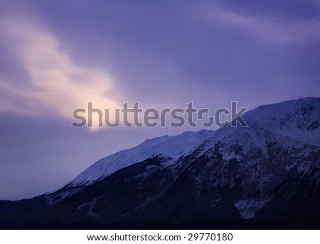 Thinly Veiled Sunlight Over The Frigid Landscape Of The Kenai Peninsula, Alaska - stock photo