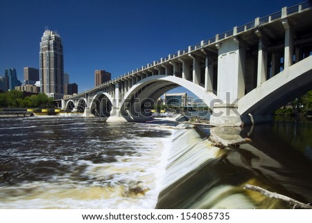 Third Avenue Bridge above Saint Anthony Falls. Minneapolis, Minnesota, USA  - stock photo