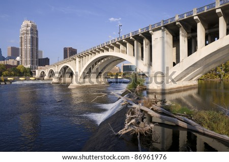 Third Avenue Bridge crossing Mississippi River above Lower Saint Anthony Falls in Minneapolis Minnesota - stock photo