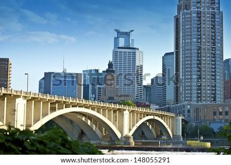 Third Avenue Bridge in Minneapolis, Minnesota. Minneapolis Skyline and Mississippi River. - stock photo