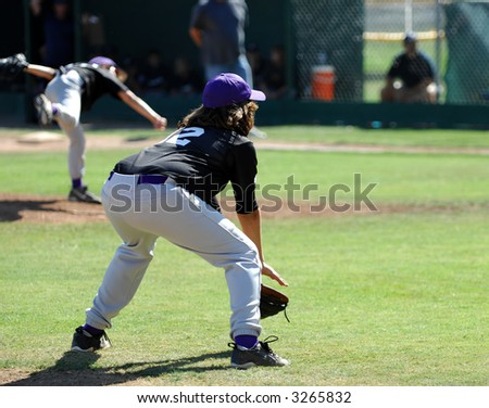 Third Baseman Ready As Pitch Delivered - stock photo