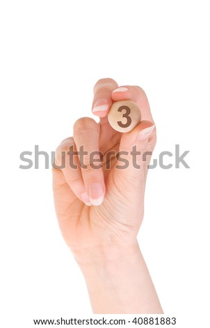 third bingo ball in the hand - stock photo