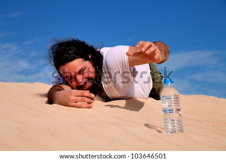 Thirst man in the desert take plastic bottle with water