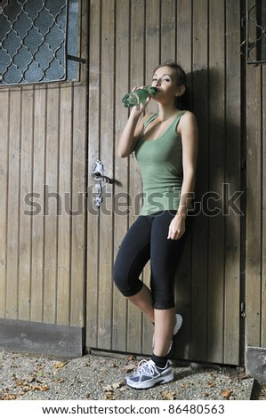 Thirsty after fitness-sports - stock photo