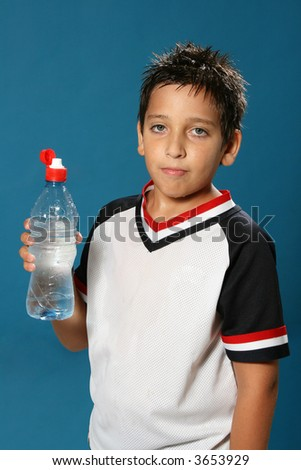 Thirsty boy drinking fresh water wearing sport clothes