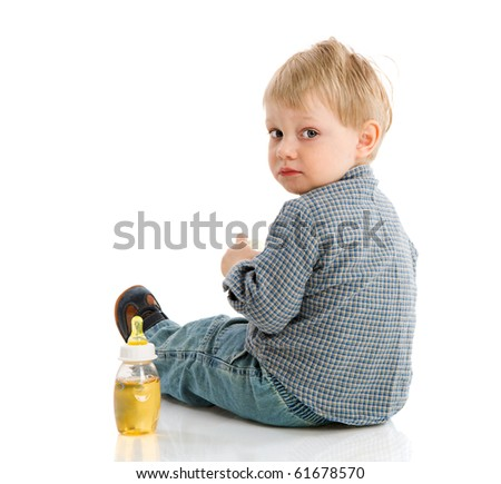 Thirsty Boy sitting with bottle isolated on white - stock photo