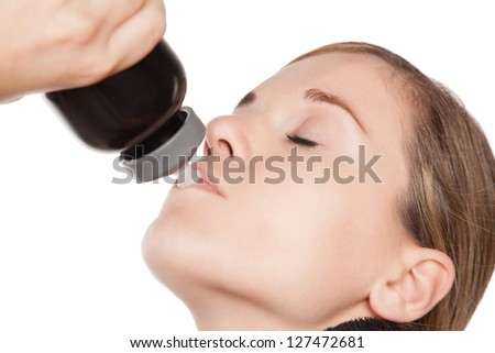 Thirsty Caucasian woman hydrating from a water bottle, close up - stock photo