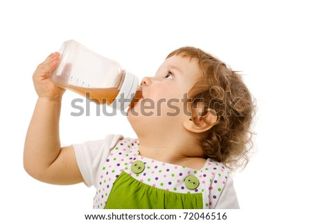 Thirsty girl drinking from bottle isolated on white