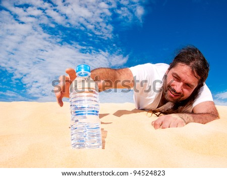 Thirsty man in the desert reaches for a bottle of water