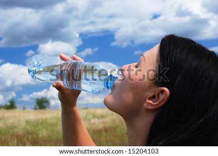 Thirsty woman - stock photo