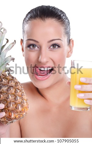 thirsty woman holding glass of pineapple juice and licks his lips - stock photo