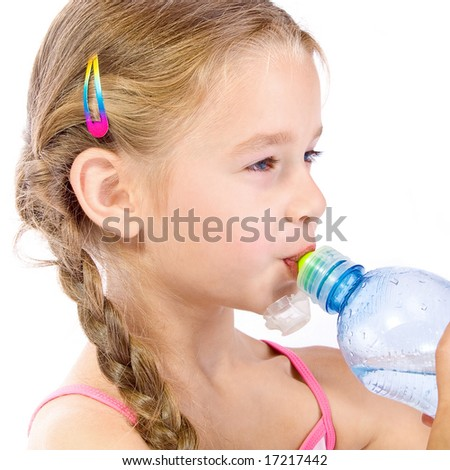 Thirsty young girl with bottle