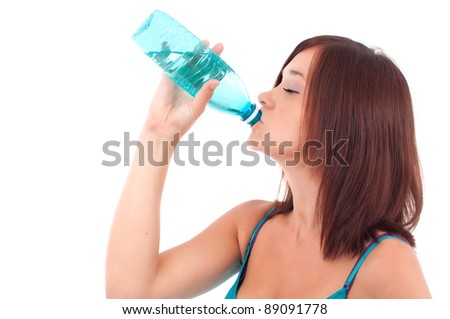 Thirsty young women drinking water after fitness workout. Isolated on white - stock photo