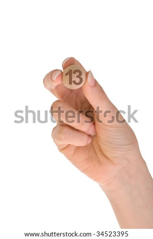 thirteenth bingo ball in the hand - stock photo