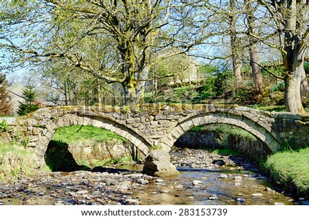 Thirteenth Century packhorse bridge in Wycoller, Lancashire. - stock photo
