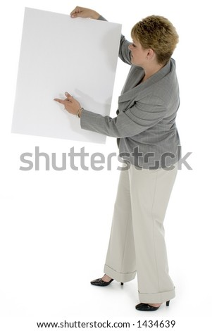 Thirty five year old business woman pointing to blank sign.