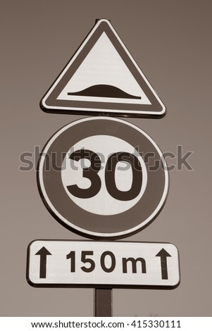 Thirty Speed Sign against Sky Background in Black and White Sepia Tone - stock photo