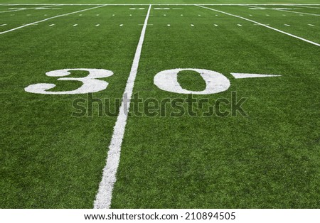 Thirty yard line on an American football field - stock photo