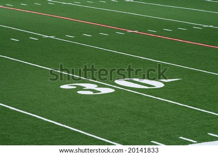 Thirty yardline on a turf football field. - stock photo