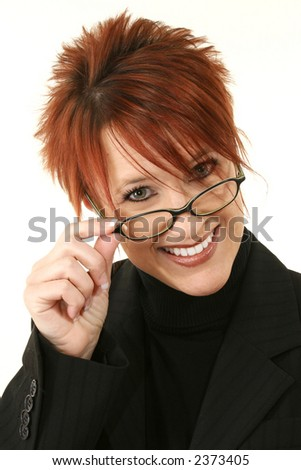 Thirty year old business woman looking over eyeglasses. - stock photo