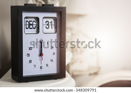 Thirtyfirst december and twelve o'clock - stock photo