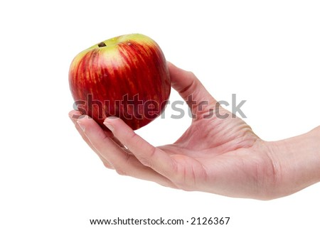 This apple is for you. Girl's hand offering a red/yellow apple - stock photo