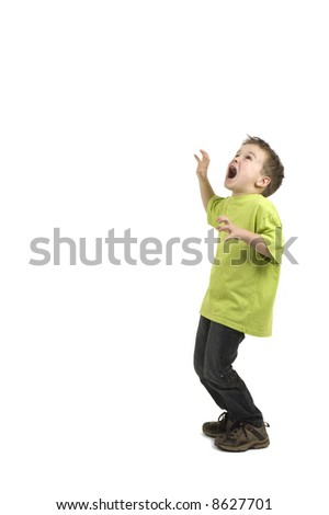 This boy is very scared. Against a white background. - stock photo