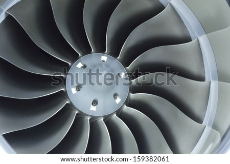 This close up image of a business aircraft jet engine inlet fan makes a great business travel background - stock photo