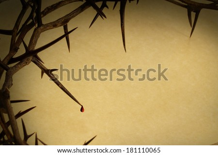 This Crown of Thorns with drop of blood against parchment paper represents Jesus's Crucifixion on the Cross, dying and then rising on Easter Sunday.  - stock photo