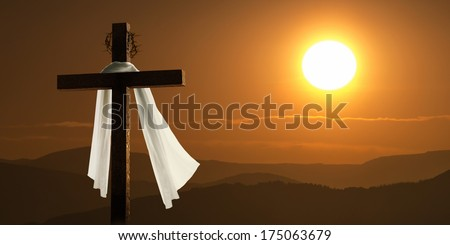 This dramatic mountain sunrise lighting and Easter Cross makes a great Easter photo illustration of Jesus dying on the cross and rising again. - stock photo