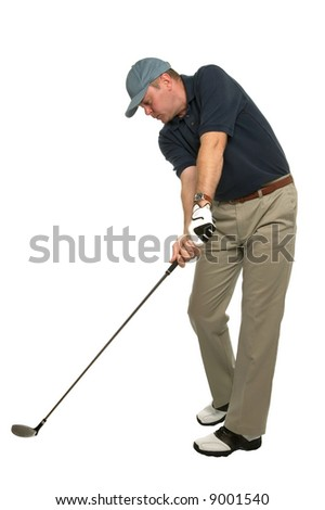This golf image demonstrates a perfect example of keeping your head still and your eye on the ball when taking a shot. - stock photo