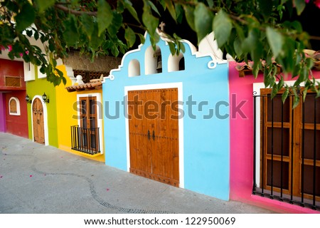 This image Bright facades of traditional Mexican architecture, in Puerto Vallarta - stock photo