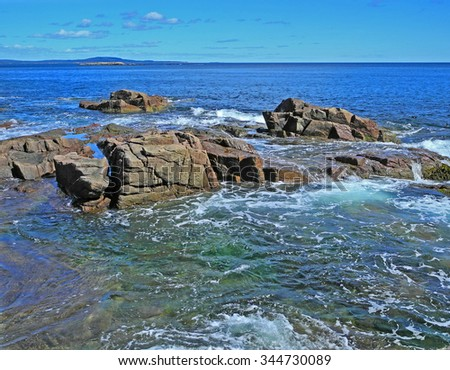 This image is one of many scenic views along the Atlantic Coast as seen from the shore near Thunder Hole in Acadia National Park.  - stock photo