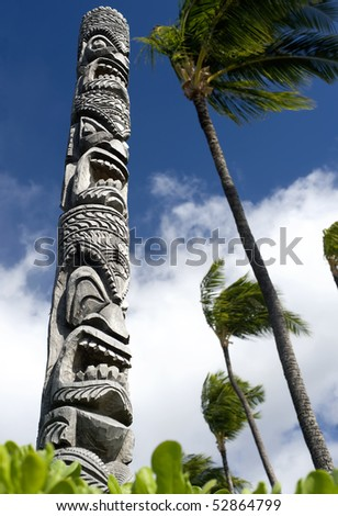 This image shows a carved tiki pole in Hawaii - stock photo