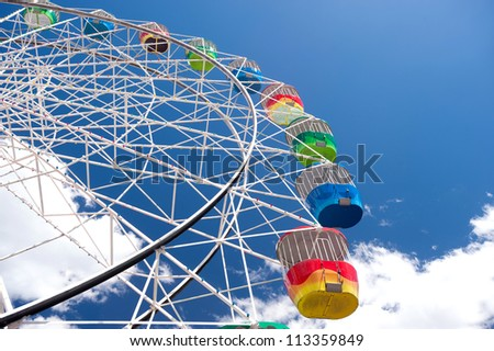 This image shows a Colourful Ferris Wheel - stock photo