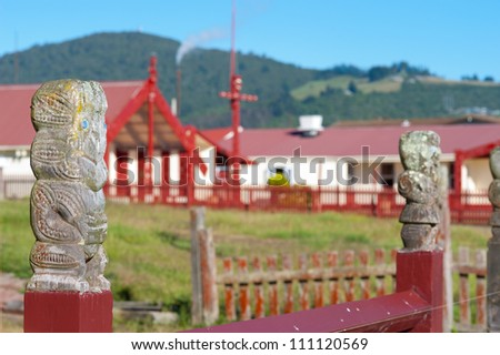 This image shows a Maori marae (meeting house and meeting ground) - stock photo