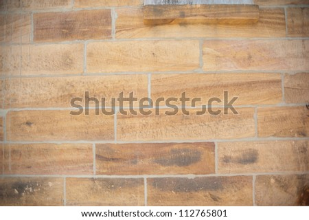 This image shows a sandstone wall on Cockatoo Island,  Sydney, Australia. - stock photo