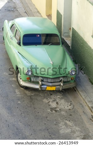 This image shows an old car in the streets of Havana, Cuba - stock photo